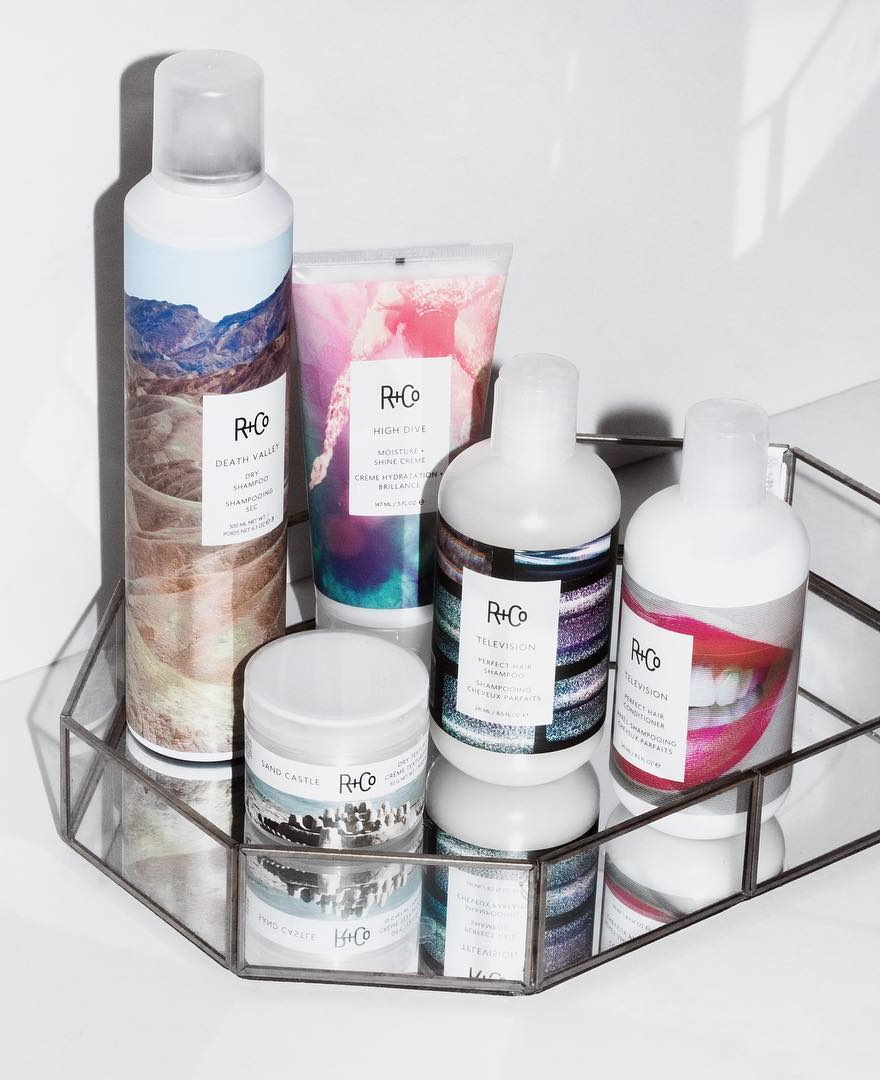 R+Co hair products in a a shower basket