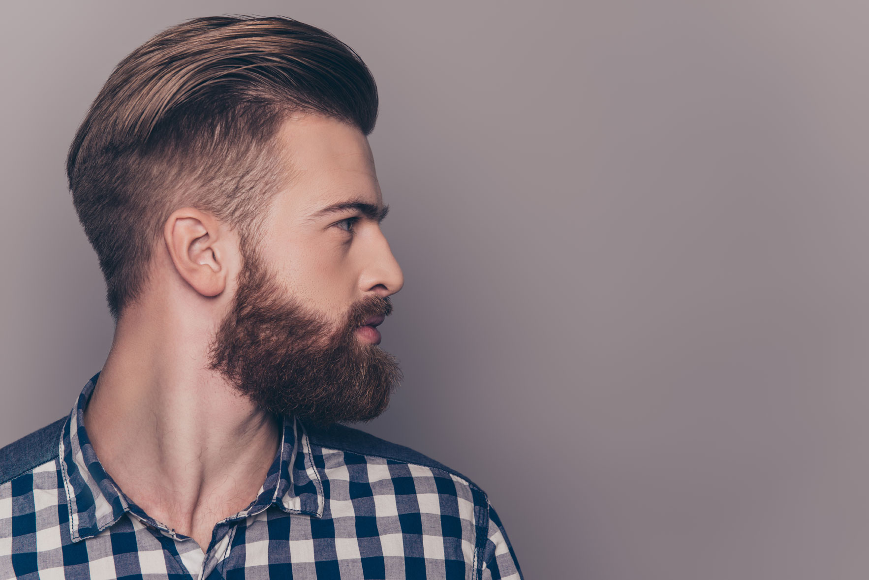 Stylish bearded guy looking to the side