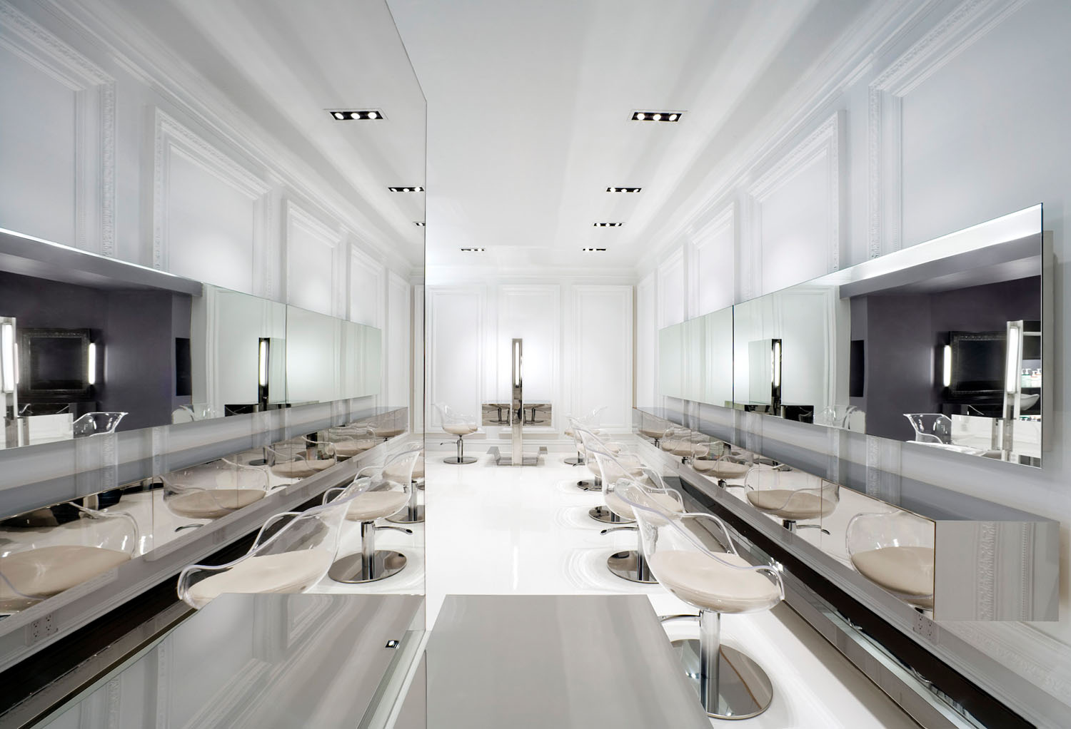 Bright white room with chairs and mirrors